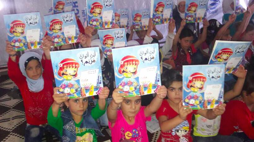 Children in Syria with books received from Project Peace